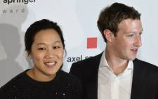 Facebook founder and CEO Mark Zuckerberg (R) arrives to receive the Axel Springer Award with his wife Priscilla Chan in Berlin on 25 February 2016. Picture: AFP.