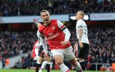 Arsenal's Lukas Podolski celebrates after scoring the second goal in the FA Cup match against Liverpool on 16 February 2014. Picture: Facebook.