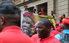 EFF members sing outside the North Gauteng High Court in Pretoria on 5 March. Picture: Sebabatso Mosamo/EWN.