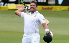 South Africa's Jacques Kallis celebrates his century to become the third leading run scorer of all time during Day 4 of the second and final cricket Test match between India and South Africa at the Sahara Stadium Kingsmead in Durban on December 29, 2013. Picture: AFP.