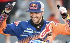 KTM's British biker Sam Sunderland celebrates on the podium of the 2017 Rally Dakar in Buenos Aires, Argentina. Picture: AFP.