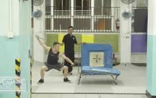 A screengrab of a stuntman in training ta the Hong Kong kung fu stunt school.