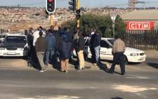 Some residents of Birch Acres gather outside Birch Acres Mall following a protest over service delivery. Picture: Kgothatso Mogale/EWN