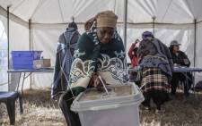 A Mosotho woman casts her ballot, at a polling station in Maseru, during Lesotho's general election. Picture: AFP