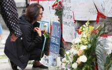 A woman prays on 24 April  2018 at a makeshift memorial for victims in the van attack in Toronto, Ontario. Picture: AFP