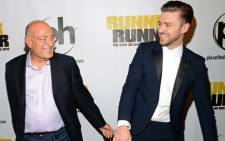 Arnon Milchan and actor Justin Timberlake arrive at the world premiere of 'Runner Runner' in September. Picture: AFP.