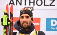 Winner France's Martin Fourcade celebrates on the podium of the Men 15 km Mass Start Competition of the IBU World Cup Biathlon in Anterselva (Antholz) on 21 January 2018. Martin Fourcade won the race ahead of Tarjei Boe of Norway, second, and Erlend Bjoentegaard, third. Picture: AFP.