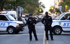 FILE: Police officers secure an area following a shooting incident in New York. Picture: AFP