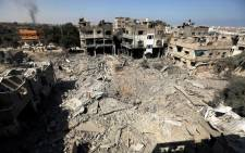 Palestinians walks across the rubble of destroyed buildings and homes in Al-Salam neighbourhood, in Jabalia in the northern Gaza Strip on 1 August 2014. Picture: AFP.
