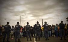 Police monitor the situation in Krugersdorp during a protest by residents on 22 January 2018. Picture: Thomas Holder/EWN