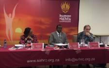 Angie Makwetla, Bongani Majola and Justice Albie Sachs at the SAHRC hearing on racism and social media on 15 February 2017. Picture: Masa Kekana/EWN.