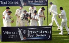 England players celebrate winning the fourth Test match, and Test series, against South Africa, on day 4 of the fourth Test match at Old Trafford cricket ground in Manchester on 7 August, 2017. Picture: AFP.