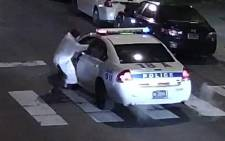 This video still image obtained 8 January, 2016 courtesy of the Philadelphia Police Department, shows a shooting suspect and police car on 7 January, 2016 in Philadelphia, PA. A self-professed sympathiser of the Islamic State extremist group shot and seriously wounded a police officer in Philadelphia, opening fire multiple times at point blank range with a stolen weapon. Picture: AFP.