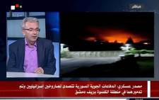 A TV grab from a broadcast by the official Syrian Arab News Agency (SANA) on 8 May 2018 shows a Syrian presenter speaking with images on the right purportedly showing the aftermath of two intercepted Israeli missiles. Picture: AFP.