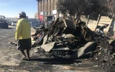 Residents of Alexandra try to salvage what's left of their belongings, after a fire that left at least 120 families homeless and killed a 16-month-old baby boy. Picture: Kgothatso Mogale/EWN