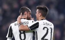 Juventus' Paulo Dybala celebrates with his team mate Claudio Marchisio after scoring. Picture: Twitter @juventusfcen.