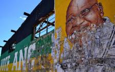 An ANC mural in a Mangaung informal settlement depicts Jacob Zuma's face. The artwork has been damaged by advertising posters. Picture: Aletta Gardner/EWN.