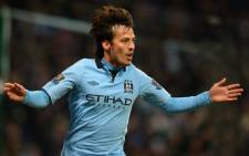 Manchester City's Spanish midfielder David Silva celebrates after scoring the second goal during the English Premier League football match between City and Fulham at The Etihad stadium on January 19, 2013. Picture: AFP