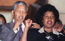 Anti-apartheid leader and African National Congress (ANC) member Nelson Mandela and wife Winnie raise fists upon Mandela release from Victor Verster prison, 11 February 1990 in Paarl. Picture: AFP.