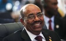 Sudanese President Omar al-Bashir smiles as he attends the 12th summit of the Organisation of Islamic Cooperation on February 6, 2013 in Cairo. Picture: AFP/GIANLUIGI GUERCIA