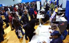 People wait in line cast their vote at Samuels Community Center in the presidential election November 8, 2016 in the Harlem neighborhood of New York City. Picture: AFP.