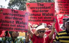 FILE: SACP supporters hold up placards during a march through Pretoria's CBD in support of Justice Minister Michael Masutha's decision to appeal the parole granted to Chris Hani's killer, Janusz Walus. Picture: EWN.