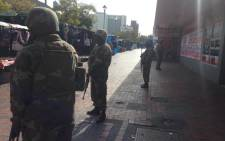 Police and army members have begun their raid as part of an anti-crime blitz in the Bellville CBD on 7 May 2015. Picture: Regan Thaw/EWN.