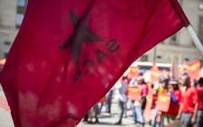 FILE: An SACP flag flies during a protest. Picture: EWN