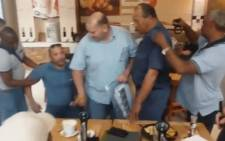 A screengrab shows two SAPS officials being arrested at a Kuils River mall. They were accused of corruption after they allegedly accepted a bribe of R10,000. Picture: Facebook.com