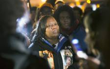 Dorothy Holmes, the mother of Ronald Johnson, joins demonstrators protesting the shooting death of her son on 7 December 2015 in Chicago, Illinois. Police say Johnson had a gun in his hand when he was shot; Johnsons family and their attorney dispute this claim. Picture: AFP