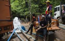 Thai rescue personnel work to pump water from the Tham Luang cave as rescue operations continue for 12 boys and their coach trapped, at the Khun Nam Nang Non Forest Park in the Mae Sai district of Chiang Rai province. Picture: AFP