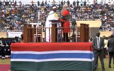Gambian President Adama Barrow (C) arrives on stage to take an oath during the inauguration ceremony for the start of his presidency at the Independence Stadium in Bakau, west of the capital Banjul, on February 18, 2017. Picture: AFP.