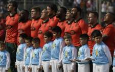 South Africa's Springboks -wearing a limited-edition alternate jersey marking the 25th anniversary of the end of apartheid in South Africa's rugby- pose during the anthem ceremony before the start of the Rugby Championship match against Argentina's Los Pumas at Padre Ernesto Martearena stadium in Salta some 1550 Km north-west of Buenos Aires, Argentina on 26 August, 2017. Picture: AFP.