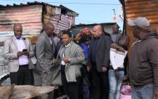 Human Settlements Minister Nomaindia Mfeketo along with Social Development Minister Susan Shabangu visited Taiwan Informal Settlement in Khayelitsha on 8 May 2018. Eight people – including five children - died in a shack fire in this community on Monday. Picture: Bertram Malgas