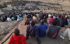 FILE: Protesters from Lonmin's Marikana Mine in the North West sit on a nearby hill, awaiting instruction from their leaders. Picture: EWN.