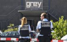 Policemen stand in front of the Grey nightclub in Konstanz (Constance), southern Germany, where a gunman opened fire, killing one and wounding four people before being shot by police, on July 30, 2017. German police said they did not believe that the shooting was a terror attack. Picture: AFP.