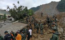 Chinese rescue workers are seen at the site of a landslide in Bijie in China's southwestern Guizhou province on 28 August 2017. Picture: AFP