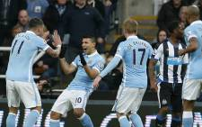 FILE. Manchester City's Sergio Aguero celebrates with team mates after scoring against Newcastle United in the English Premier League on 19 April 2016. Picture: Manchester City official Facebook page.