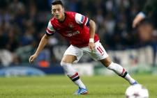 FILE: Arsenal's German midfielder Mesut Ozil controls the ball during the UEFA Champions League Group F match against Arsenal on 1 October 2013. Picture: AFP