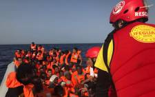 Spanish Proactiva Open Arms charity personnel rescue migrants off Libya. Picture: @proactivaservice/Facebook.com.