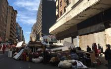 Residents were evicted from a building between Harrison and Jeppe streets on 19 July 2017. Picture: Tebogo Tshwane/EWN