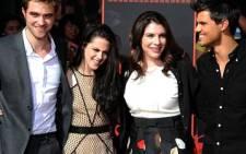 Actors Robert Pattinson, Kristen Stewart and Taylor Lautner with The Twilight Saga author Stephenie Meyer. Picture: Valerie Macon/AFP