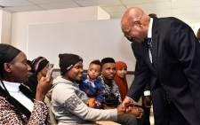President Jacob Zuma greets refugees during his tour of the Desmond Tutu Refugee Reception Centre. Picture: GCIS