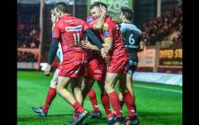 Scarlets players celebrate during a match against Toulon on 20 January 2019. Picture: @scarlets_rugby/twitter.