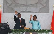 Sworn in Angolan President Joao Lourenco (L) and his wife Ana Dias de Lourenco wave to the crowd at the end of his swearing in ceremony as the new Angolan President on 26 September 2017 in Luanda. Picture:  AFP