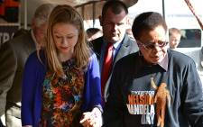 Graa Machel walks hand in hand with Chelsea Clinton after the former US President and his daughter arrived at the No Moscow school in Qunu on 17 July 2012. Picutre: Aletta Gardner/EWN