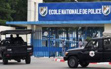 A picture taken on 20 July 2017 shows two vehicles of the Ivorian police's special forces outside the entrance to the National Police Academy in the district of Cocody in Abidjan, where gunshots were reportedly fired on July 19. Picture: AFP.