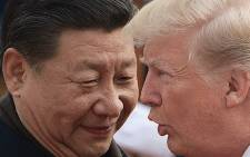 China's President Xi Jinping (L) and US President Donald Trump attend a welcome ceremony at the Great Hall of the People in Beijing on 9 November 2017.  Picture: AFP.
