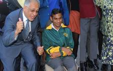 Joshua Chetty (seated) is one of the country's top matric achievers for the class of 2017. Picture: @DBE_SA/Twitter