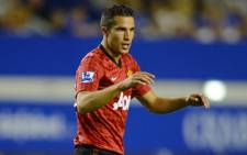 Robin van Persie and his Manchester United teammates take on Olympiakos in the Champions League tonight. Picture: AFP